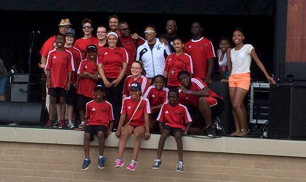 Banks with members of the Black Star Drum Line following their performance at Summerfest 2014.